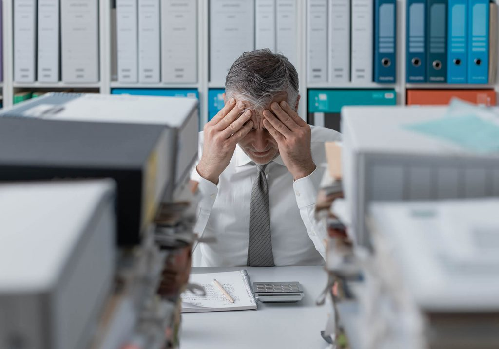 stressed-business-executive-with-bookkeeping