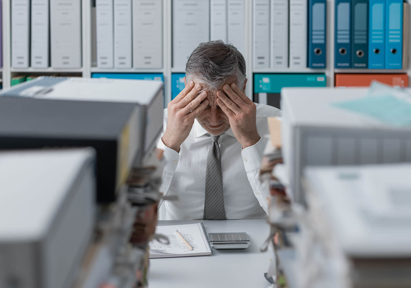 business executive stressed due to bookkeeping mistake
